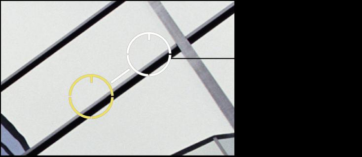 Abbildung. Weiße Überlagerung zur Kennzeichnung der Quelle über einem Teil des Bilds, aus dem die Pixel geklont werden sollen.