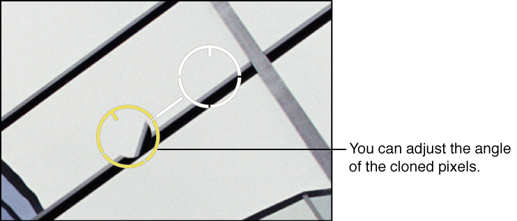 Figure. Image showing a yellow Spot & Patch target overlay placed over an area of the image containing cloned pixels that need an Angle adjustment.