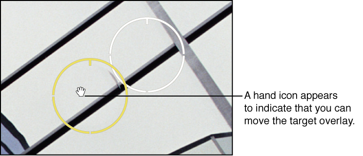 Figure. Image showing a hand icon appearing over the Spot & Patch target overlay to indicate that you can select it.