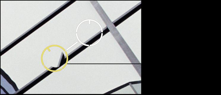Figure. Image affichant un repère Repérer et corriger jaune placé sur une zone de l'image contenant les pixels clonés nécessitant un ajustement Angle.