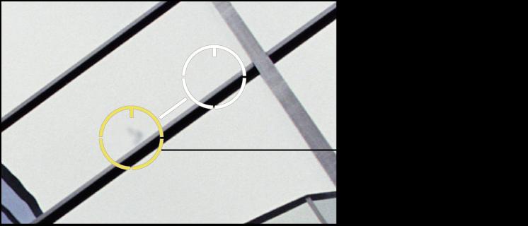 Figure. Image affichant un ajustement Adoucissement pour les pixels situés dans le repère Repérer et corriger.