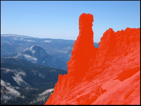 Figure. Image affichant une incrustation sur la zone de l'image sur laquelle l'ajustement a été appliqué à l'aide du pinceau.