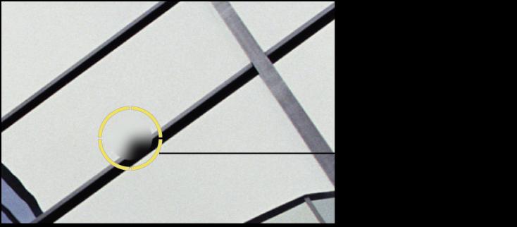 図。 イメージの問題のある個所の上に置かれている黄色の「スポットとパッチ」ターゲットオーバーレイが表示されているイメージ。