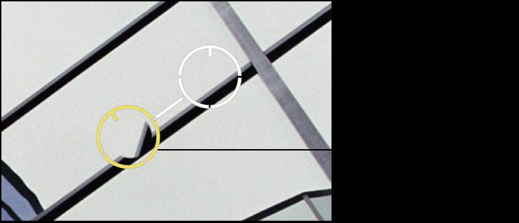 図。 「アングル」調整が必要な複製されたピクセルを含むイメージの領域の上に、黄色の「スポットとパッチ」ターゲットオーバーレイが配置されているイメージ。
