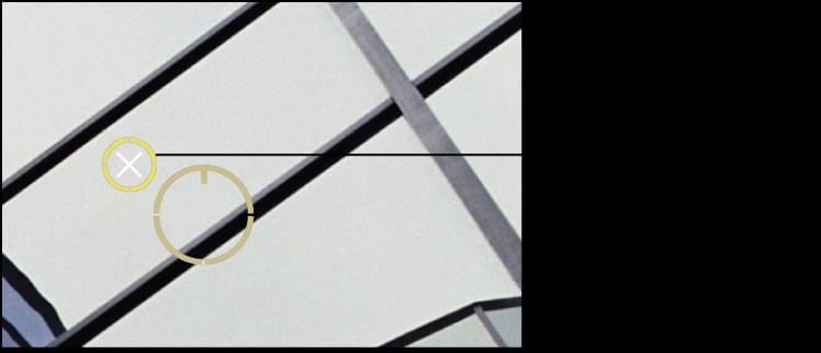 図。 「スポットとパッチ」ターゲットオーバーレイの上に白い X が表示されているイメージ。そのオーバーレイを削除できることを示しています。