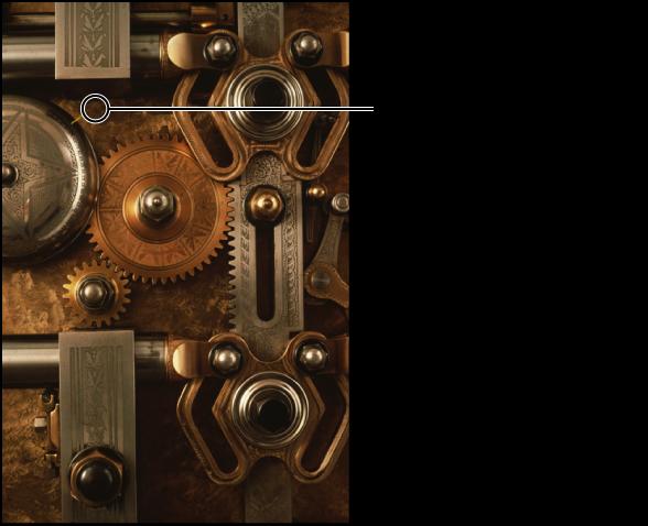図。 「クローン」ブラシの位置を示す円形のオーバーレイが表示されているイメージ。