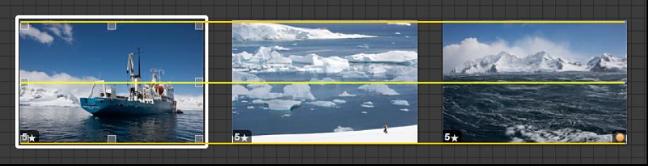 図。 ドラッグされるイメージ。目で確認しながらイメージをライトテーブル内のほかのイメージと揃えるのに役立つ黄色いガイドラインが表示されています。