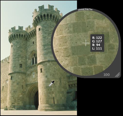 图。 放大镜放大显示图像中的中间范围颜色像素。