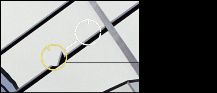 """图。 图示为黄色的""""修复和修补""""目标叠层,放在一个图像区域上,该区域包含需要执行角度调整的克隆像素。"""