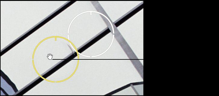 """图。 图示为""""修复和修补""""目标叠层上出现的手形图标,指示您可以移动该叠层。"""