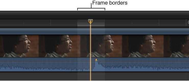 Clip in Timeline zoomed in to show audio waveform within borders of video frame