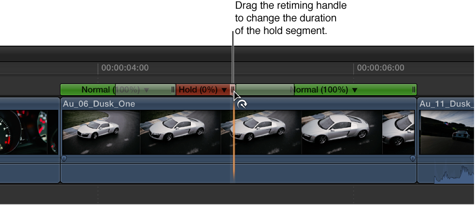 Timeline showing retiming handle of hold segment being dragged to adjust duration