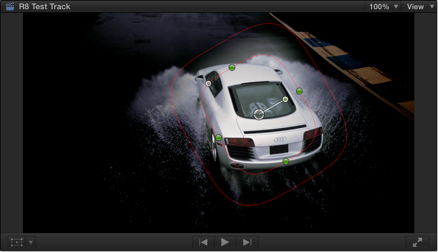 Viewer showing shape mask around an image of car with everything outside of mask darkened
