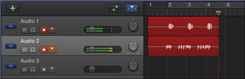 Ilustración. Se muestran pasajes de audio grabados en dos pistas de audio en el área Pistas.