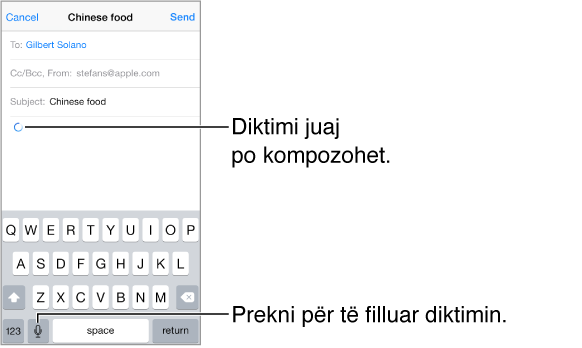 Një mesazh emaili që hartohet: Aty ku do të vendoset teksti i diktuar shfaqet një shigjetë rrethore. Tasti i diktimit shfaqet në tastierë, në të majtë të tastit të hapësirës.
