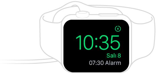 Şarj cihazını taktığınızda ve Digital Crown ile yandaki düğme yukarıda olacak şekilde Apple Watch'u yan koyduğunuzda, Apple Watch saati ve bir sonraki alarmı görüntüler.